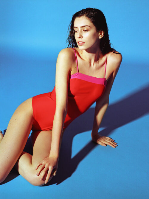 Red one-piece with pink stripe